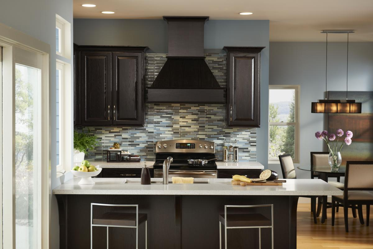 Blue kitchen brown cabinets for Dark blue kitchen paint