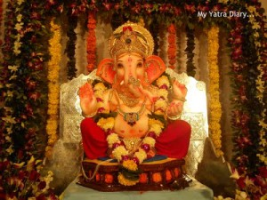 Ganpati pandal with flowers and garlands decoration