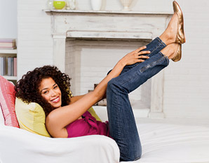 woman-relaxing-home-couch-destress-1110-298x232