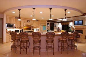luxurious-modular-curve-kitchen-island-design-overlooking-with-clasys-bar-stools-surrounding__________________________________________________________