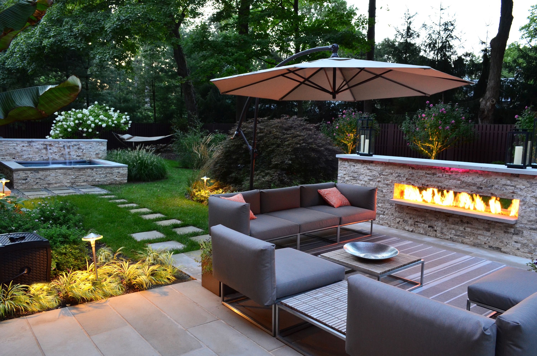 luxury-modern-backyard-sitting-area-modern-outdoor-fireplace-designs-20140706100905-53b9204196be4
