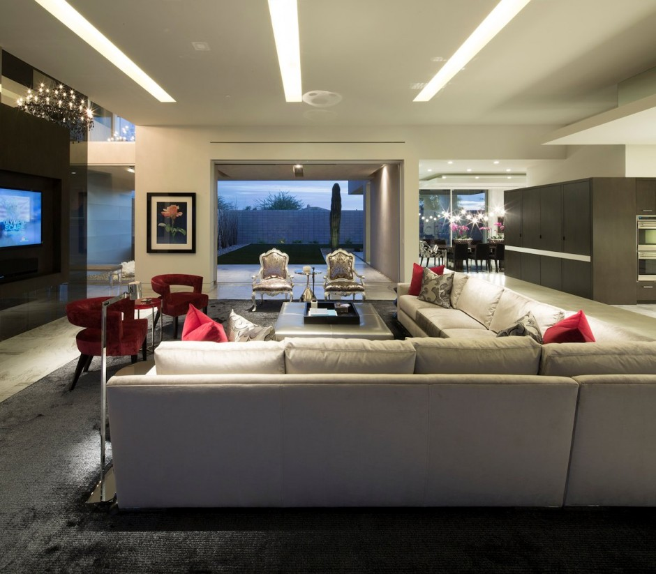 Exotic-living-room-design-with-dark-carpet-and-modern-sofa-and-red-chair-with-long-flat-lamp-on-the-ceiling