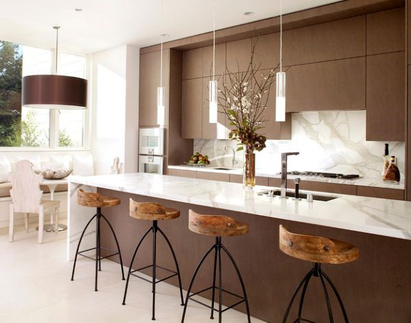 Exquisite-modern-kitchen-in-white-and-brown-with-sleek-pendant-lights-above-the-kitchen-island