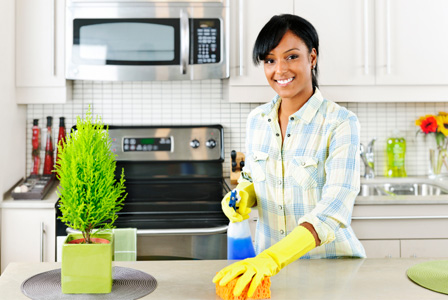 Woman-cleaning-kitchen