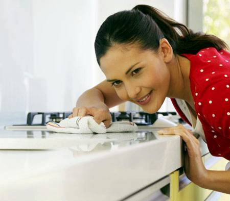 women-cleaning-kitchen-countertop-from-dirt-picture (1)