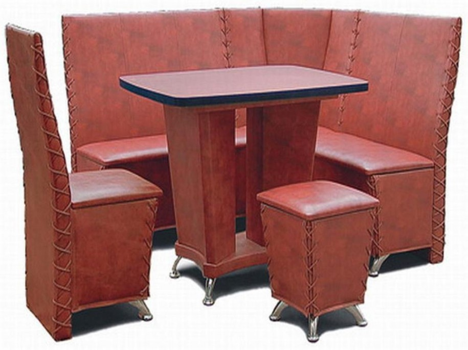 perfect-soft-maroon-sofas-with-single-chairs-and-lower-puff-with-fantastic-table-has-a-slop-in-the-middle-915x686